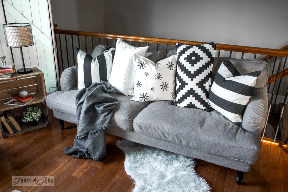 Cozy Ikea Stocksund sofa with DIY winter snowflake and black and white pillow scheme | funkyjunkinteriors.net