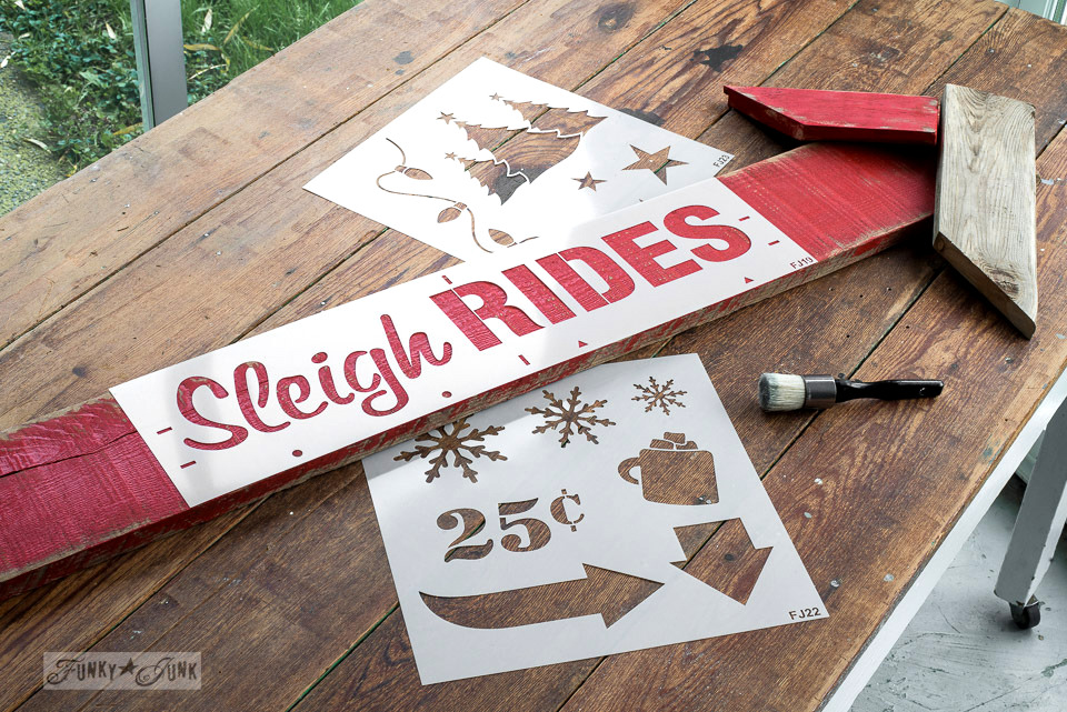 The making of a reclaimed wood Christmas Sleigh Rides arrow sign, made with Funky Junk's Old Sign Stencils and Fusion Mineral Paint | funkyjunkinteriors.net
