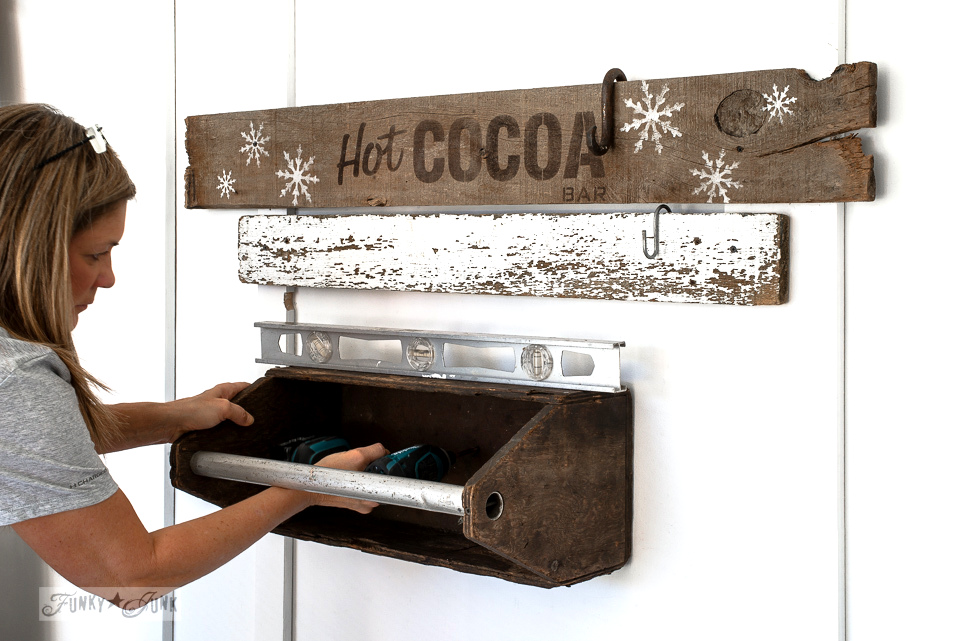 Mounting a toolbox shelf to create a hot cocoa station, using Funky Junk's Old Sign Stencils | funkyjunkinteriors.net