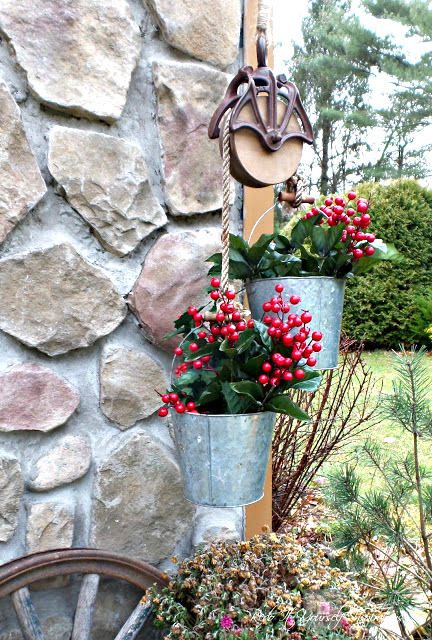 Farmhouse pulley and bucket planters for Christmas, by Redo it yourself Inspirations, featured on Funky Junk Interiors