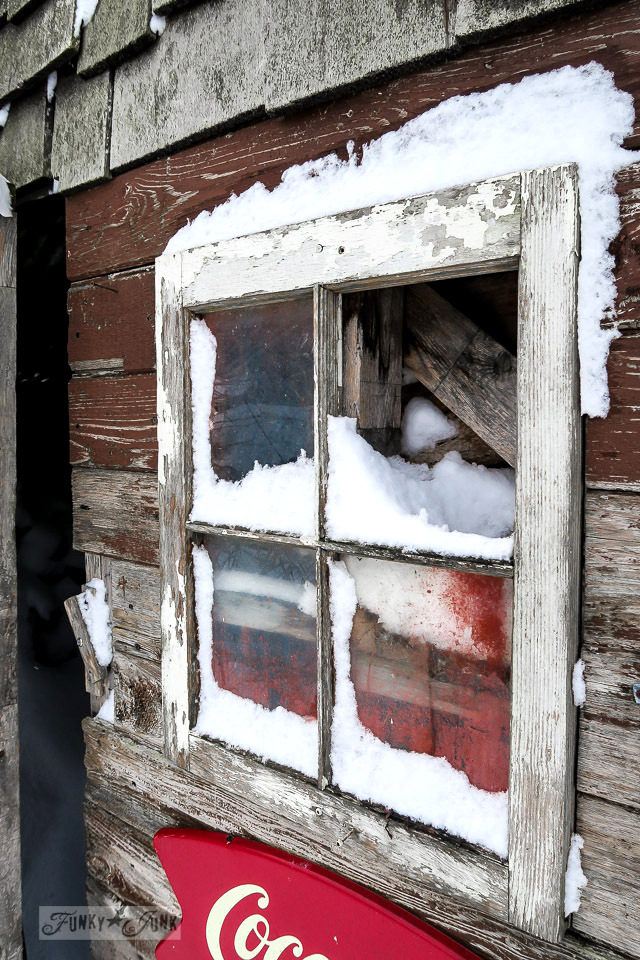 rustic barn window caught in the snow | funkyjunkinteriors.net