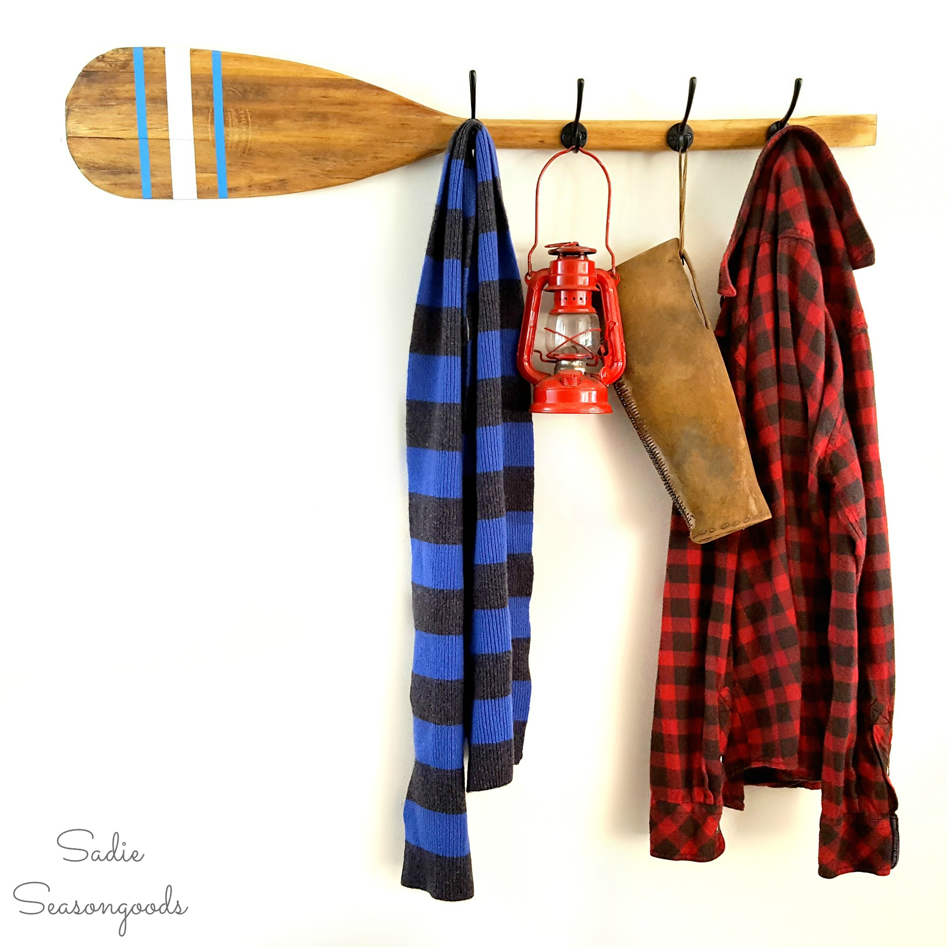 Vintage canoe paddle coatrack, by Sadie Seasongoods, featured on Funky Junk Interiors
