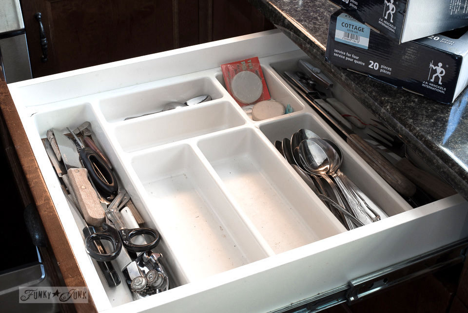 dirty cutlery drawer before