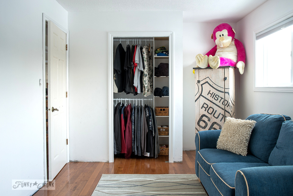 boy's bedroom, with enhanced simple closet and sitting area
