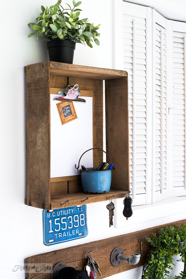 Industrial farmhouse reclaimed wood pipe coat hooks and crate message centre for an entry | funkyjunkinteriors.net