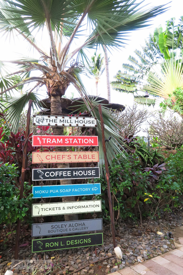 Metal directional signs beside meandering walking paths, at The Mill House in Maui. A dream restaurant for junkers, plus, located at The Maui Tropical Plantation. | funkyjunkinteriors.net