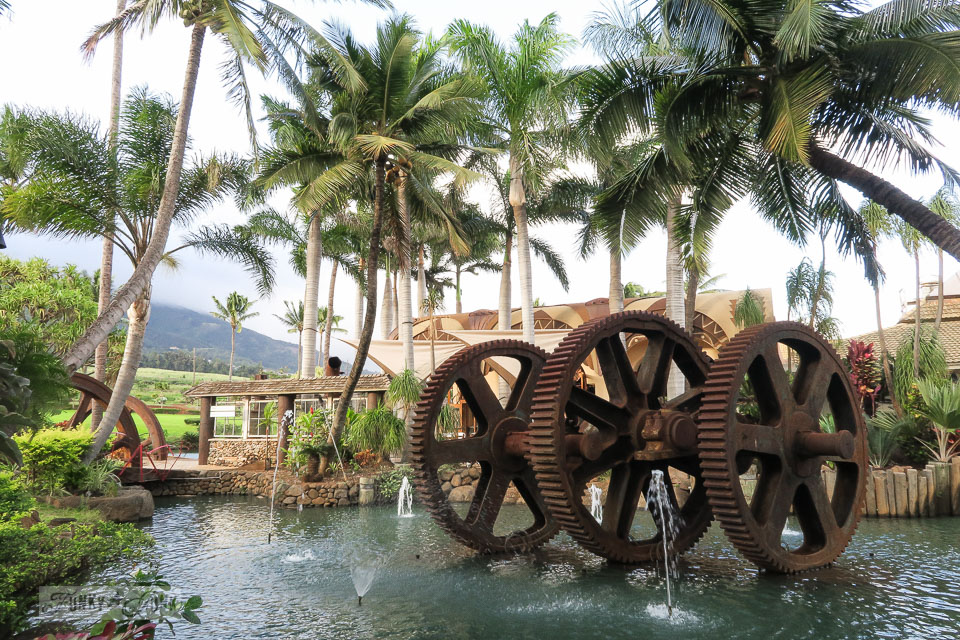 Rusty gear water fountain in a pond, at The Mill House in Maui. A dream restaurant for junkers, plus, located at The Maui Tropical Plantation. | funkyjunkinteriors.net