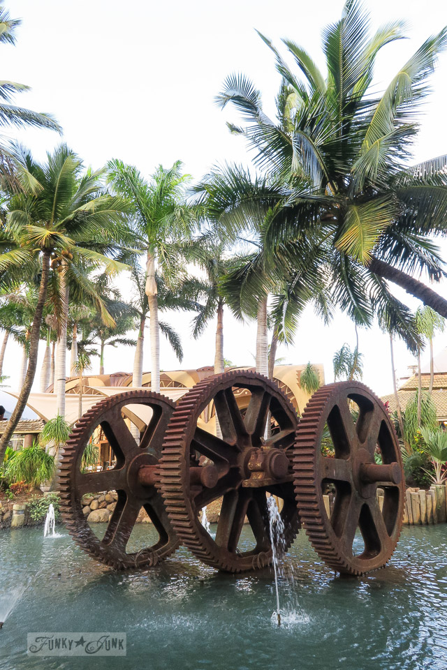 Rusty gear water fountain at The Mill House in Maui. A dream restaurant for junkers, plus, located at The Maui Tropical Plantation. | funkyjunkinteriors.net