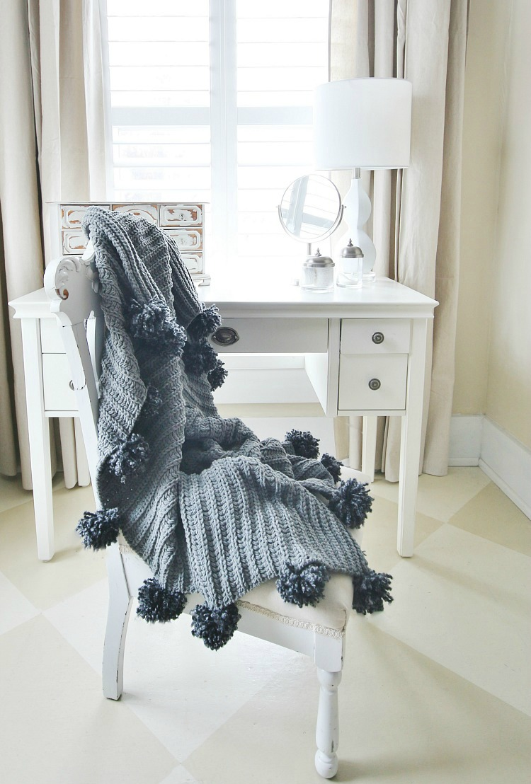 No sew pom poms on a cozy blanket, by Thistlewood Farms, featured on Funky Junk Interiors