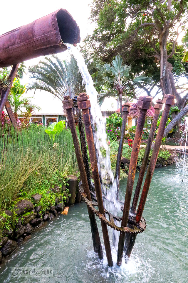 A rusty pipe, nuts and bolts waterfall feature at The Mill House in Maui. A dream restaurant for junkers, plus, located at The Maui Tropical Plantation. | funkyjunkinteriors.net