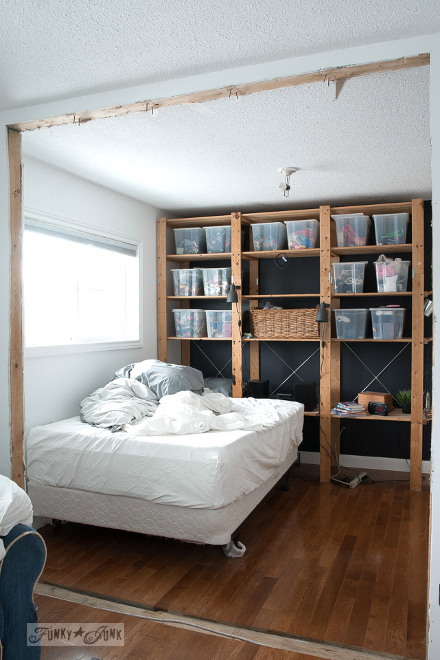 teen's bedroom, with Ikea wooden wall unit against a black wall