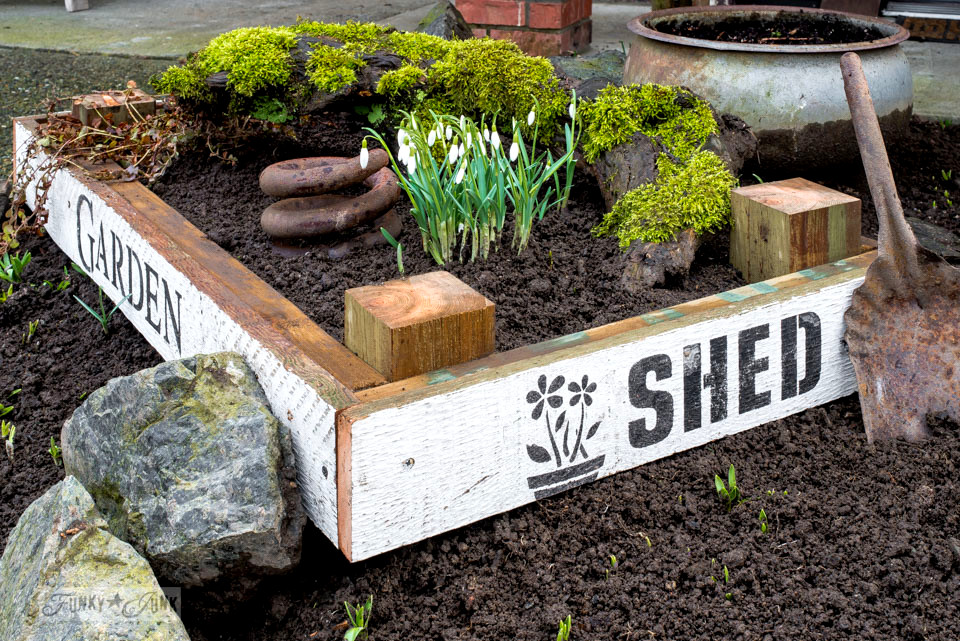 Oversized tulip crate flowerbed with Garden Shed stenciling