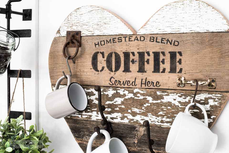 Learn how to create this reclaimed wood coffee sign mug hanger using scrap wood planks and a stencil! Featuring Homestead Blend Coffee from Funky Junk's Old Sign Stencils. Click for full tutorial and view 2 other ways to use this reclaimed wood heart! #coffeesign #hearts #reclaimedwood #signs