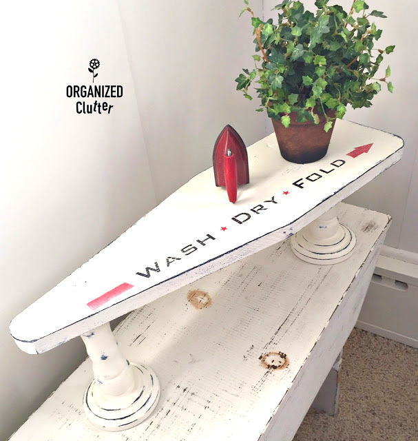 Mini laundry room ironing board turned shelf, by Organized Clutter, featured on Funky Junk Interiors