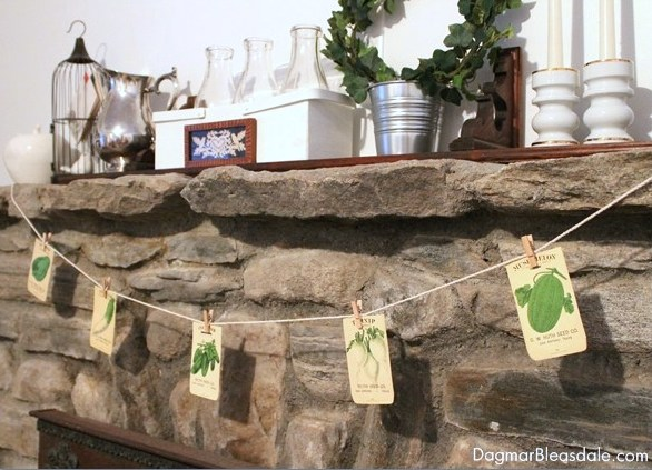 Spring mantel with DIY vintage seed packets banner, by Dagmar's Home, featured on Funky Junk Interiors