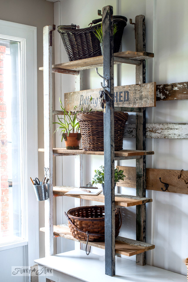 Quirky 2 ladder shelving in the entry with reclaimed wood planks for shelves, with a Potting Shed sign made with Funky Junk's Old Sign Stencils | funkyjunkinteriors.net