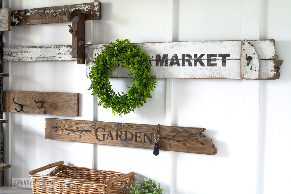 Garden themed rustic signs for coat hooks on an entry wall using Funky Junk's Old Sign Stencils | funkyjunkinteriors.net