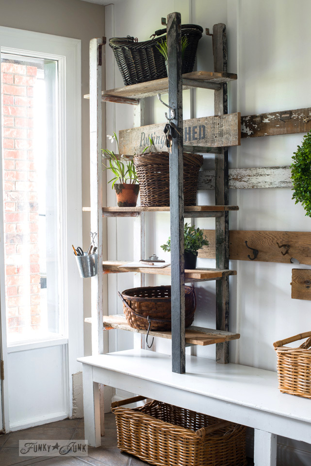 Quirky 2 ladder shelving in the entry with reclaimed wood shelving, and a Potting Shed sign using Funky Junk's Old Sign Stencils | funkyjunkinteriors.net
