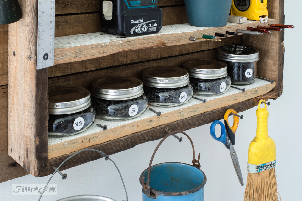 Compact mason jars filled with screws in a mini tool station | funkyjunkinteriors.net