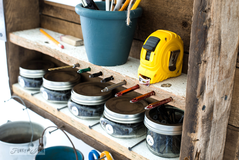 Storing drill bits inside holes drilled into a shelf | funkyjunkinteriors.net
