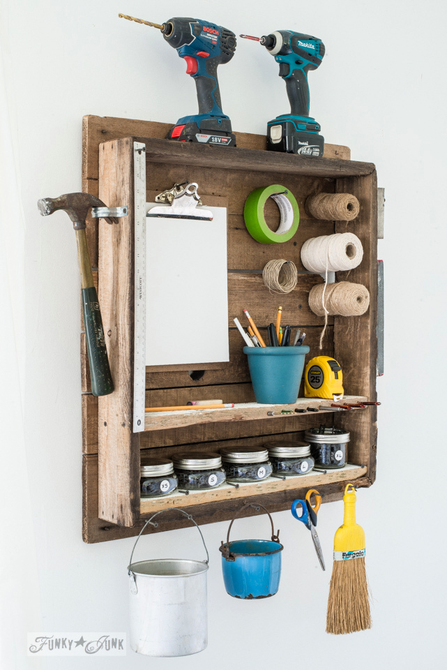 Old table top turned tool and mason jar screw storage for an indoor photo studio | funkyjunkinteriors.net