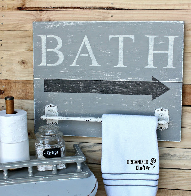 Bath towel holder with sign, by Organized Clutter, featured on Funky Junk Interiors