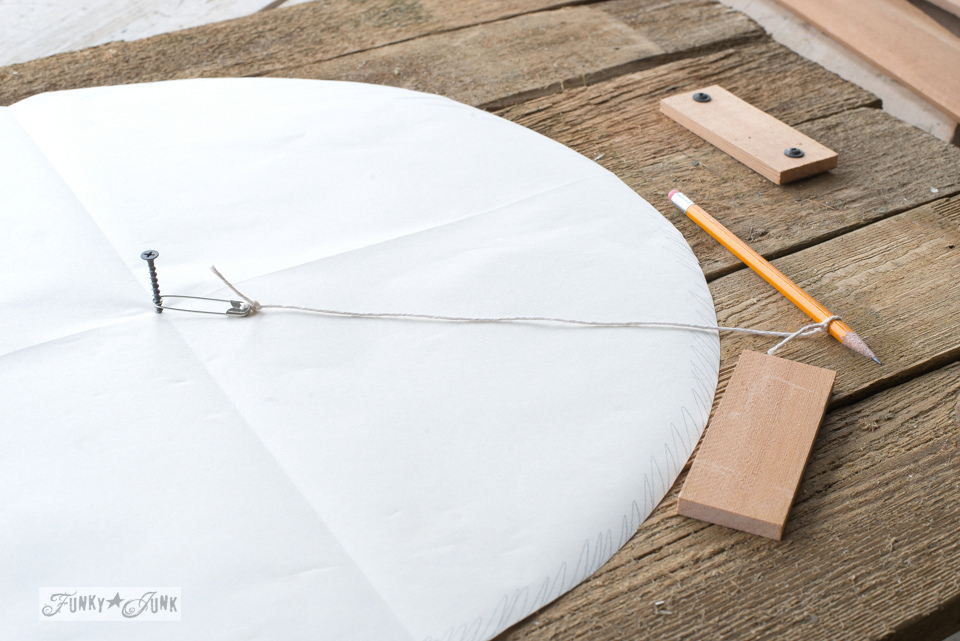 How to draw a perfect circle using a screw, pin, string and pencil to make a charming faux farmhouse clock! Click for full tutorial.