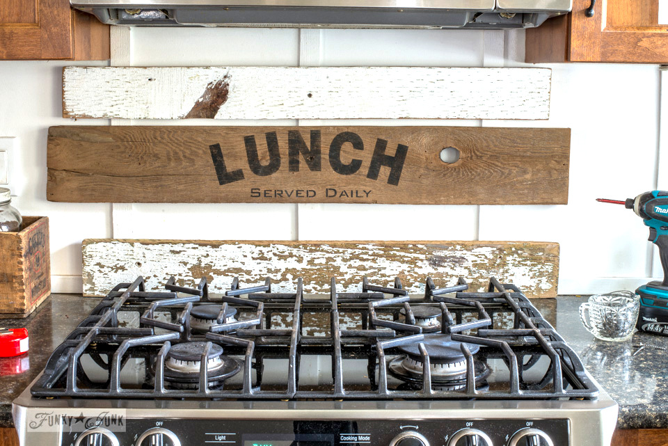 Installing interchangeable rustic farmhouse kitchen signs with Pantry, Lunch, Coffee using Funky Junk's Old Sign Stencils | funkyjunkinteriors.net