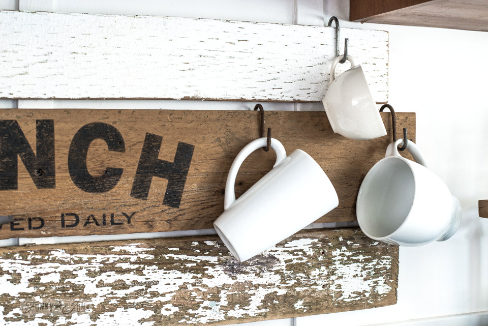 Coffee mugs hang from interchangeable rustic farmhouse kitchen signs with Pantry, Lunch, Coffee using Funky Junk's Old Sign Stencils | funkyjunkinteriors.net