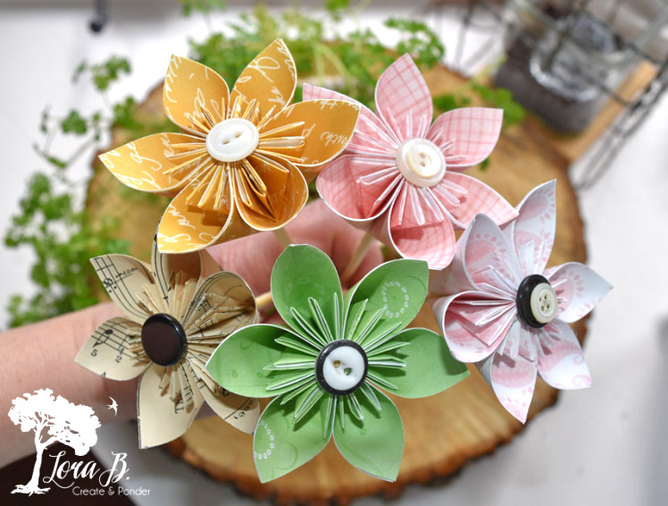 Origami flowers with buttons, by Lora B, featured on Funky Junk Interiors