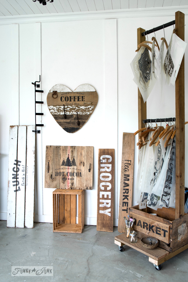 A reclaimed wood sign filled backdrop | How I set up a cheap live broadcasting studio | funkyjunkinteriors.net