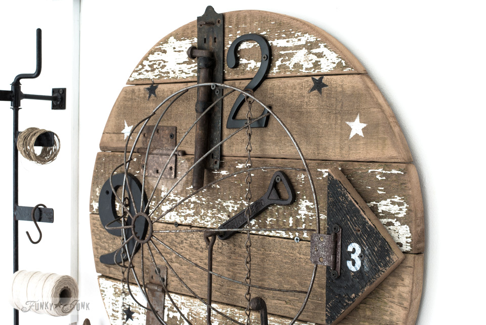 Stenciling stars onto a salvaged junk clock made from reclaimed wood, using Funky Junk's Old Sign Stencils | funkyjunkinteriors.net