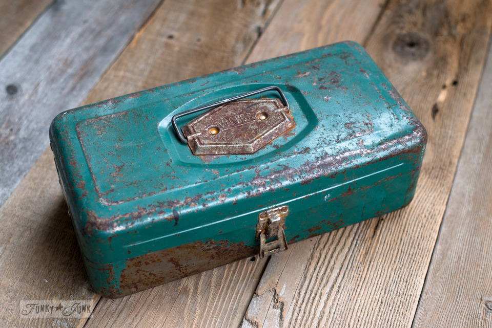 Vintage green tackle box used as an office organizer | funkyjunkinteriors.net
