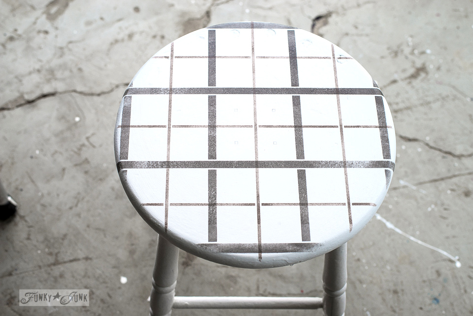 A stenciled black and brown Plaid Shirt effect on a white stool. Made with Funky Junk's Old Sign Stencils | funkyjunkinteriors.net