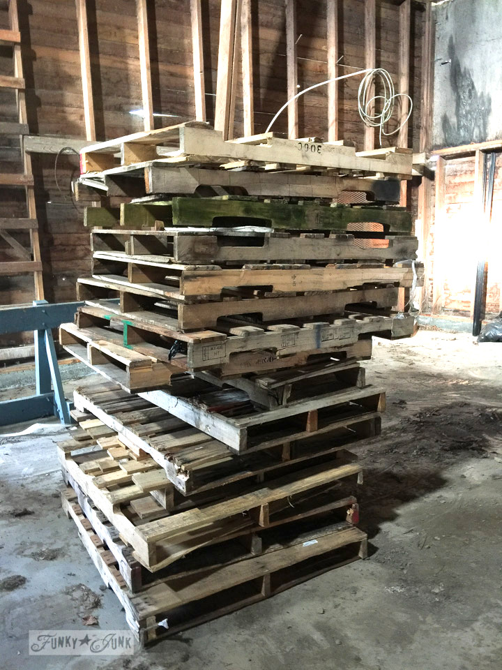 Stacks of wooden pallets inside a barn deemed for demolition