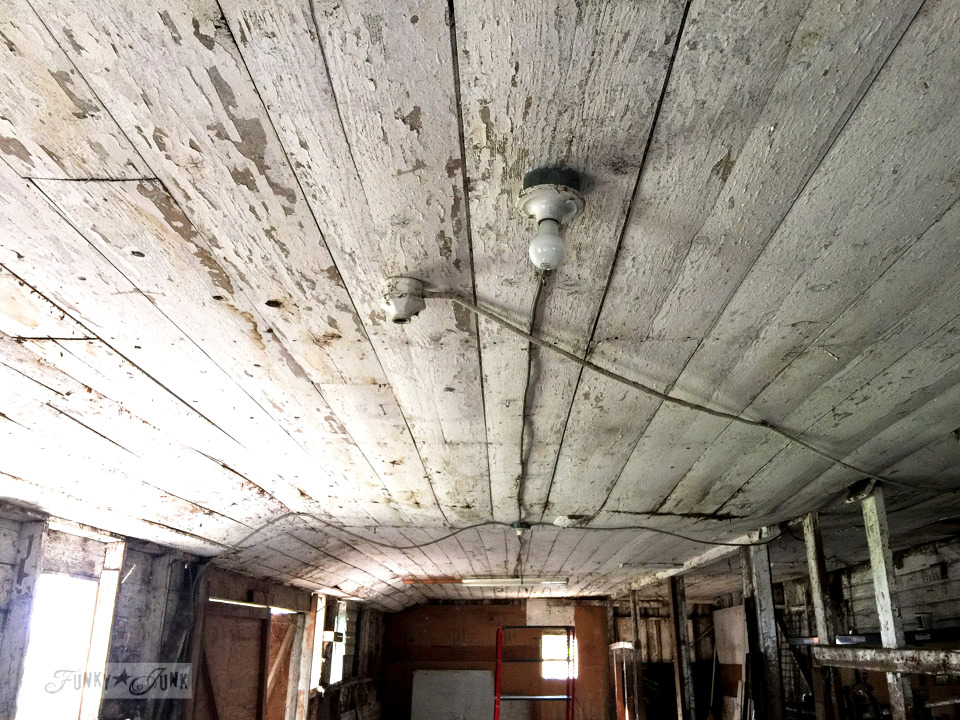 Chippy white barn ceiling during a barn demolition