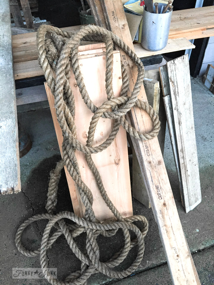 wood planks and a thick rope found in an old barn
