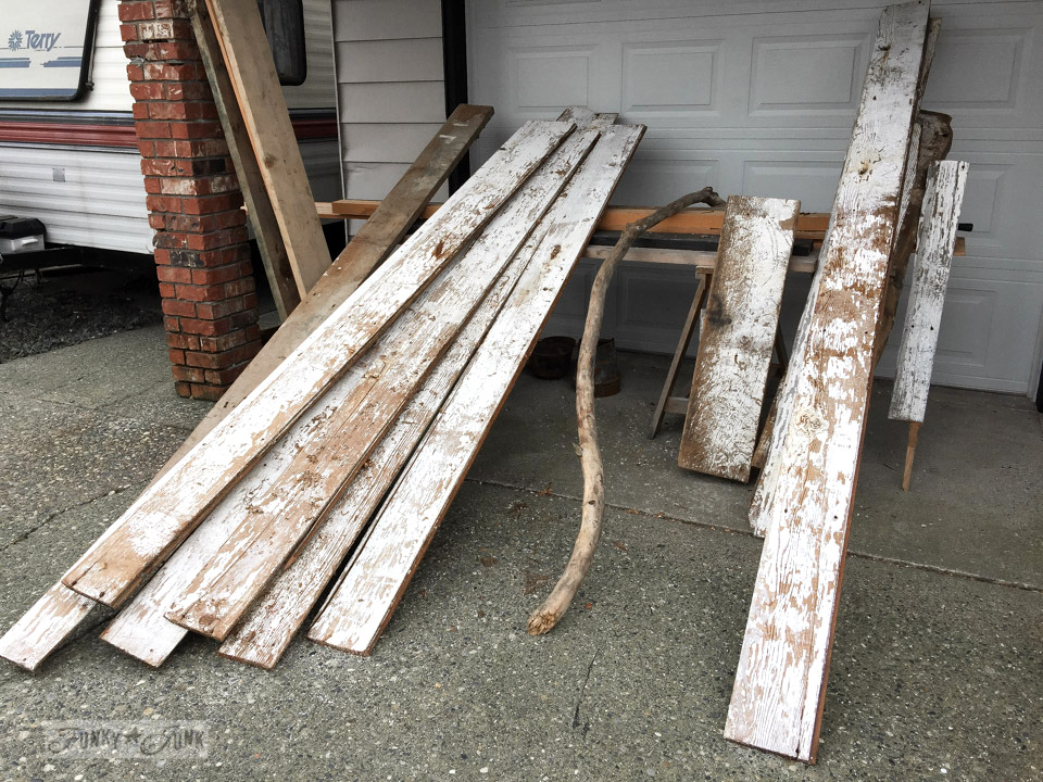 chippy white barn wood harvested from a ceiling in an old barn bound for demolition
