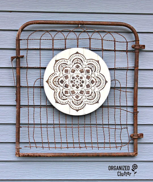 Mandala garden art from rummage sale clock, by Organized Clutter, featured on Funky Junk Interiors