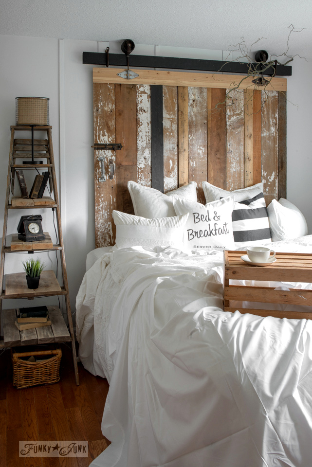 Learn how to make this faux barn wood barn door headboard and a step ladder side table! Click for full tutorials!