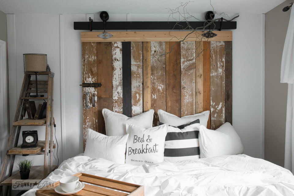A cheater reclaimed wood barn door headboard with faux hardware. Get the look without the expense or difficulty using rusty junk for hardware! funkyjunkinteriors.net