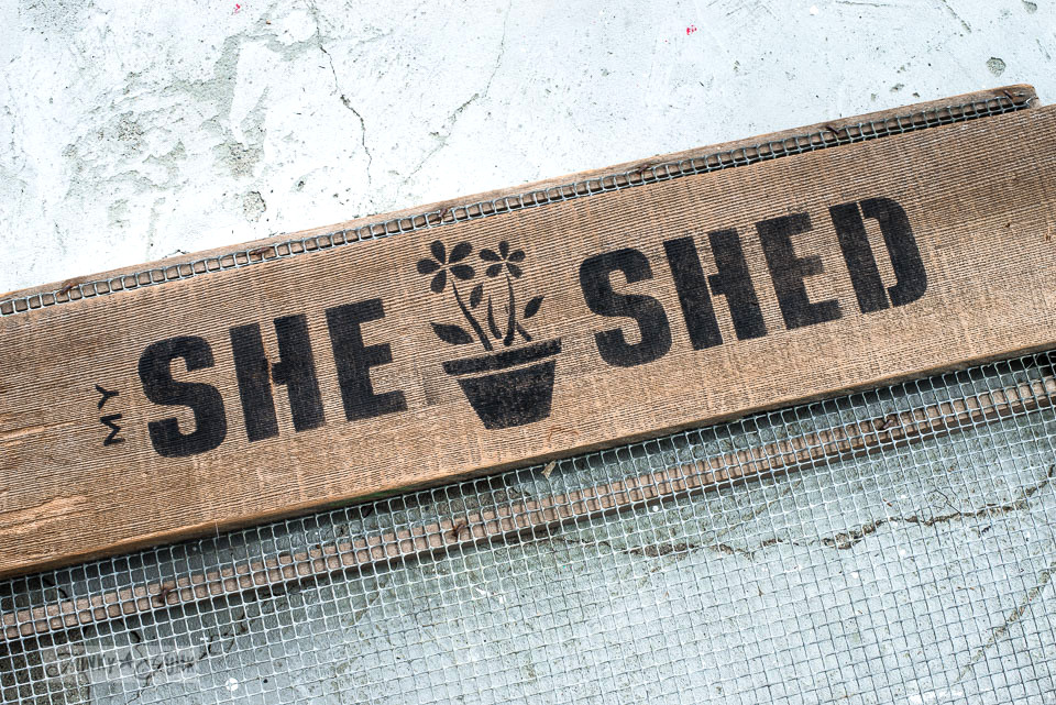 Stenciled She Shed in black on reclaimed wood to create a soil sifter gardening station with Funky Junk's Old Sign Stencils | funkyjunkinteriors.net