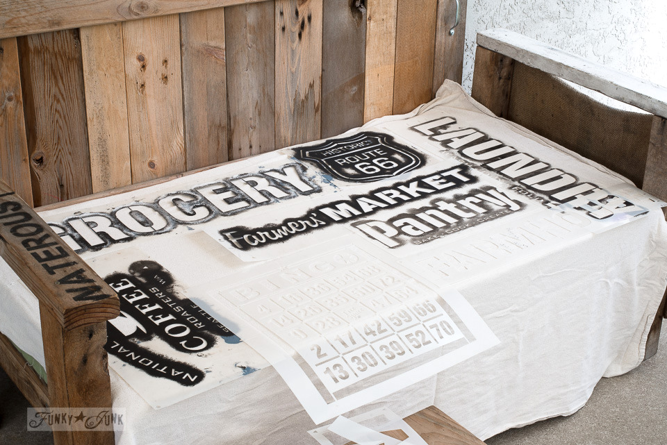 Stenciling sign stencils onto painter's drop cloth for patio furniture fabric | Funky Junk's Old Sign Stencils