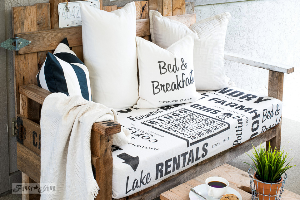 Black and white themed sign stenciled fabric for the pallet wood chairs, subway style with Funky Junk's Old Sign Stencils | funkyjunkinteriors.net