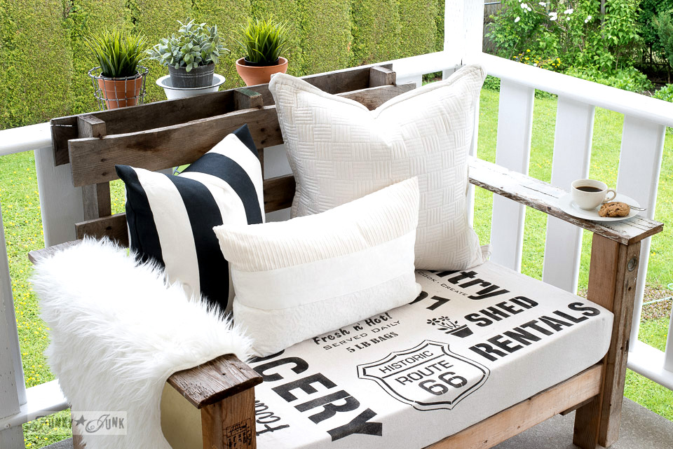 Black and white themed sign stenciled fabric for the pallet chairs, subway style with Funky Junk's Old Sign Stencils | funkyjunkinteriors.net