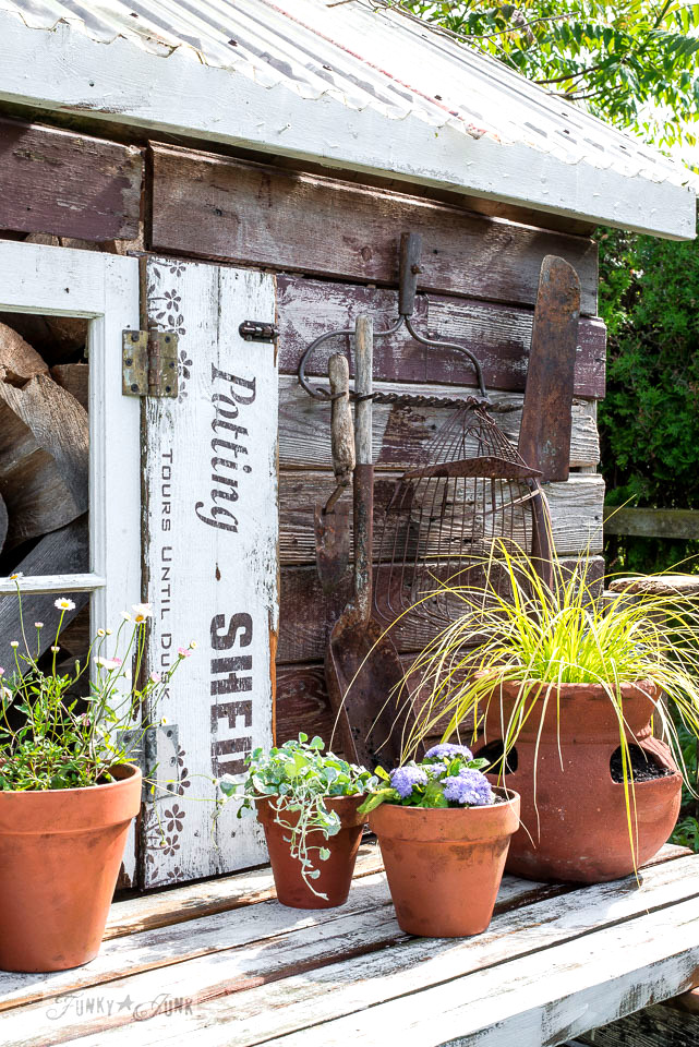 The shed gets old sign styled Potting Shed shutters, and new potted flowers for summer! With Funky Junk's Old Sign Stencils \ funkyjunkinteriors.net