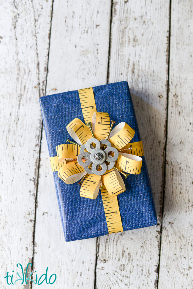 Tape measure flowers for hardware styled gift wrap, by Tikkido, featured on Funky Junk Interiors