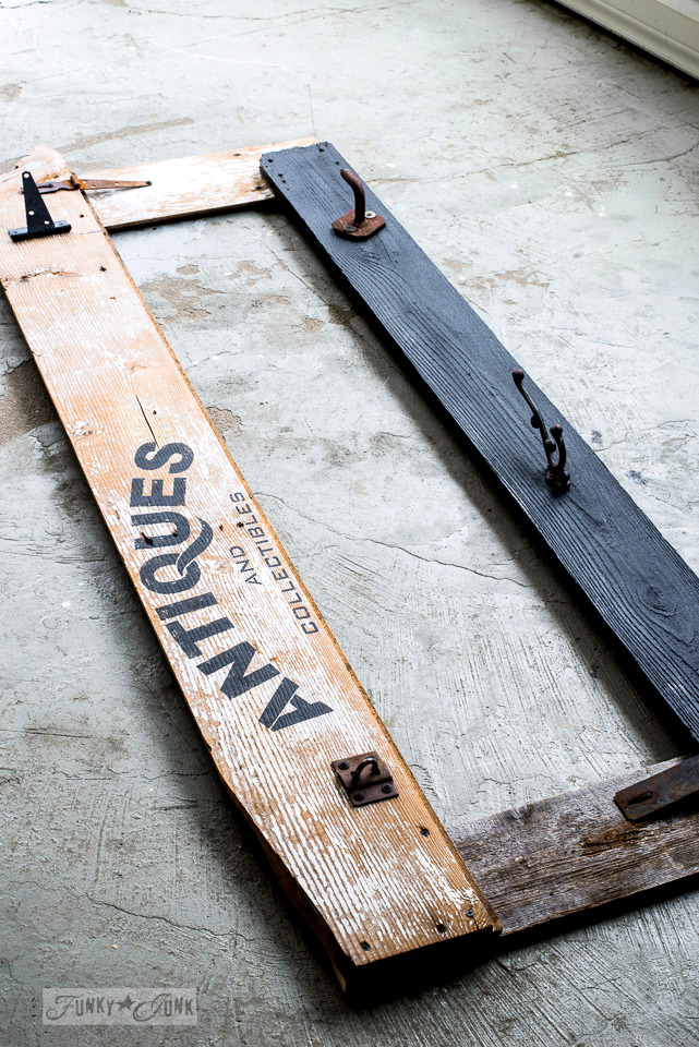 Reclaimed wood mirror frame with rusty hooks and Antique sign, made with Funky Junk's Old Sign Stencils' Antiques | funkyjunkinteriors.net