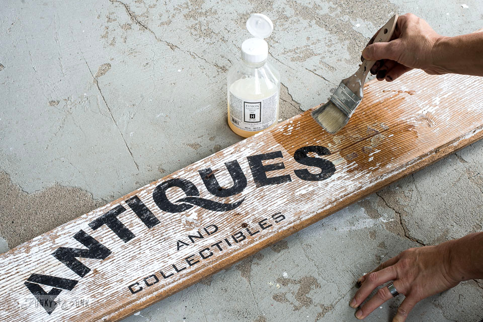 How to protect a stenciled Antiques sign made with Funky Junk's Old Sign Stencils and chippy barn wood using Fusion Mineral Paint's Tough Coat | funkyjunkinteriors.net