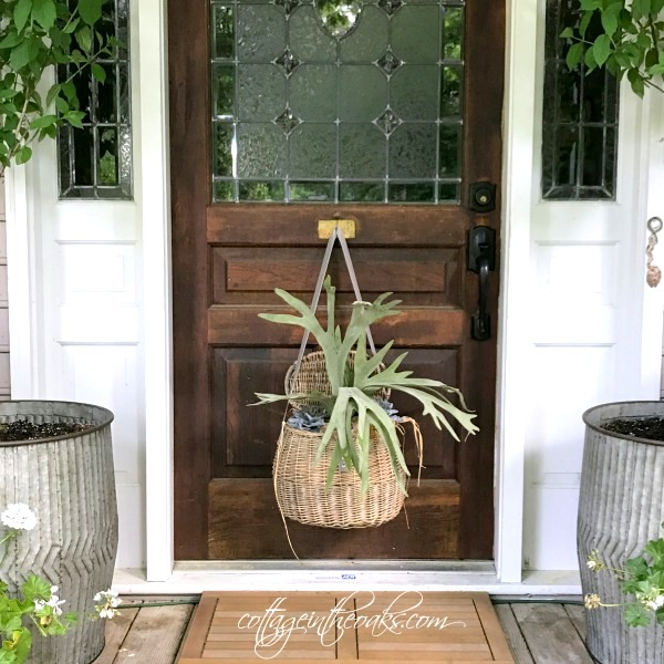 Fishing basket front door planter, by Cottage In The Oaks, featured on Funky Junk Interiors